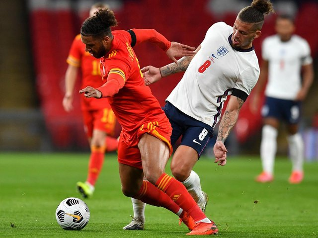 FRIENDLY FIRE - Tyler Roberts came up against Leeds United team-mate Kalvin Phillips when Wales met England. Roberts has been called up again. Pic: Getty