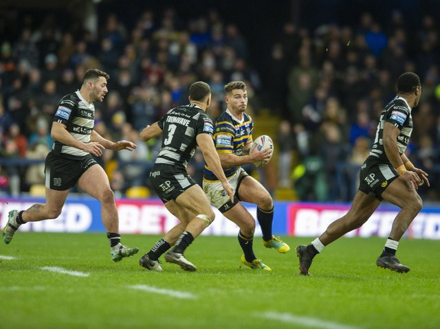 Stevie Ward takes on Hull's defence in his final game for Rhinos, in February last year. Picture by Tony Johnson.