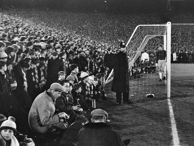 RECORD CROWD: Fans watch from the edge of the Elland Road pitch as Leeds United take on Sunderland in the FA Cup replay of March 1967. Picture by Varleys.