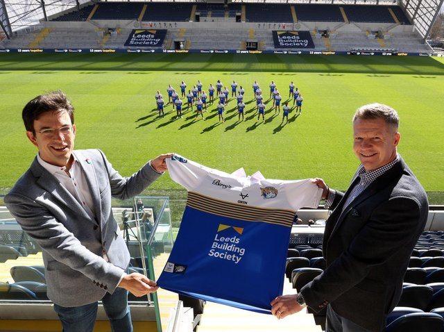 Leeds Building Society chief executive Richard Fearon, left, with Rhinos commercial director Rob Oates, in front of the - socially distanced - first team squad.