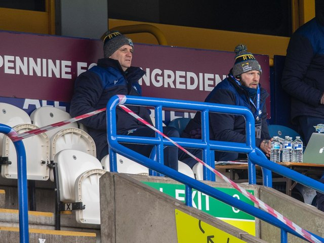 Coach Richard Agar, left, watches Rhinos in action at Huddersfield, alongside assistant Sean Long. Picture by Tony Johnson.