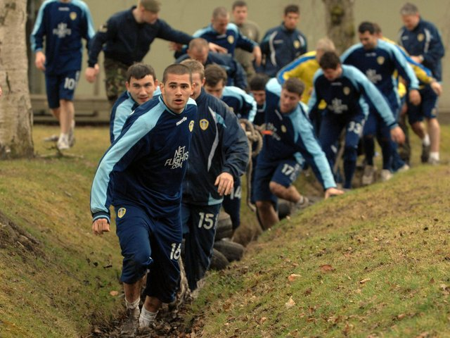 Enjoy these photo memories from the day the Leeds United squad took on an army assault course. PIC: Gerard Binks