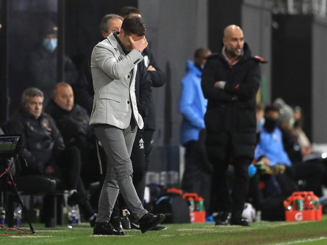 SETBACK: For Fulham boss Scott Parker, left, in Saturday's 3-0 defeat against Manchester City at Craven Cottage. Photo by Adam Davy - Pool/Getty Images.