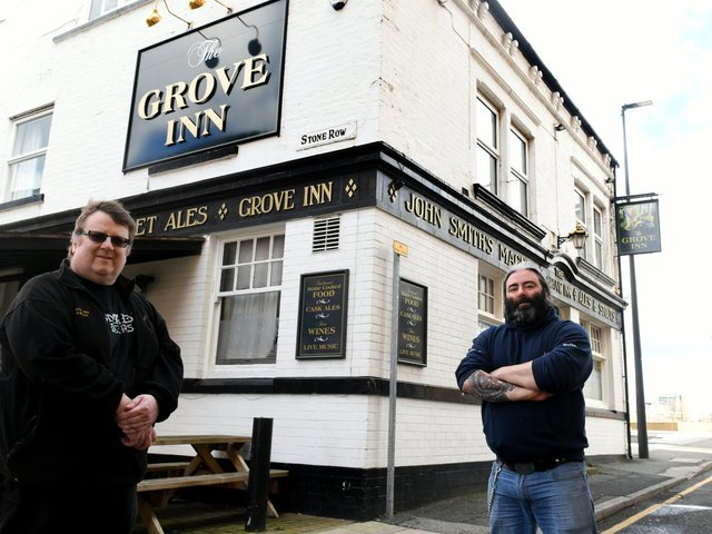 Tony Jenkins (left) chairman of the Leeds branch of CAMRA outside The Grove pub in Holbeck, Leeds with Dave Knowlson, landlord of The Grove.  Photo: Gary Longbottom