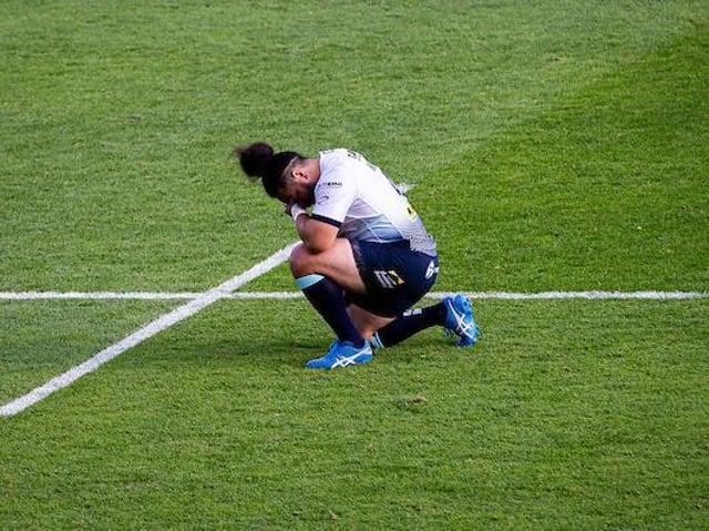 Leeds Rhinos' Konrad Hurrell takes a knee before a Super League game last season. Picture by Alex Whitehead/SWpix.com