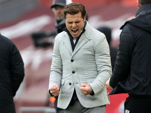 IMPROVING: Fulham boss Scott Parker shows his delight after the 1-0 victory against Liverpool at Anfield earlier this month. Photo by CLIVE BRUNSKILL/POOL/AFP via Getty Images.