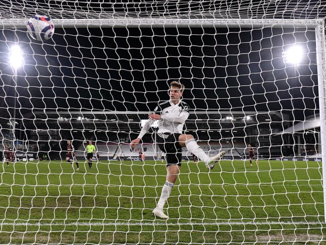 FRUSTRATION: Fulham defender Joachim Andersen blasts the ball into the net after Raphinha's Leeds United winner in Friday night's clash at Craven Cottage. Photo by Justin Setterfield/Getty Images.