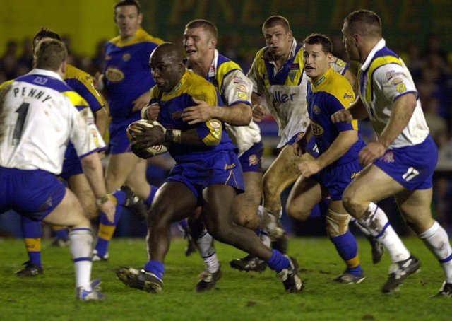 Darren Fleary runs through the middle of the Warrington defence on this day in 2002. Picture: Steve Riding.