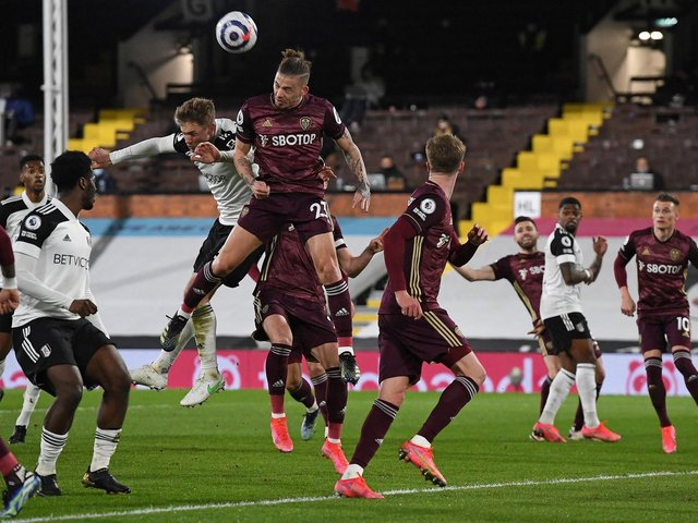 FLYING HIGH: Leeds United midfielder Kalvin Phillips clears one of Fulham's 13 corners in Friday night's 2-1 victory at Craven Cottage. Photo by ANDY RAIN/POOL/AFP via Getty Images.