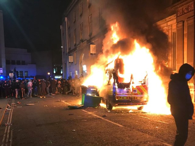 The scenes in Bristol on Sunday as police cars were set on fire and torched by pockets of the protesters. Photo: SWNS
