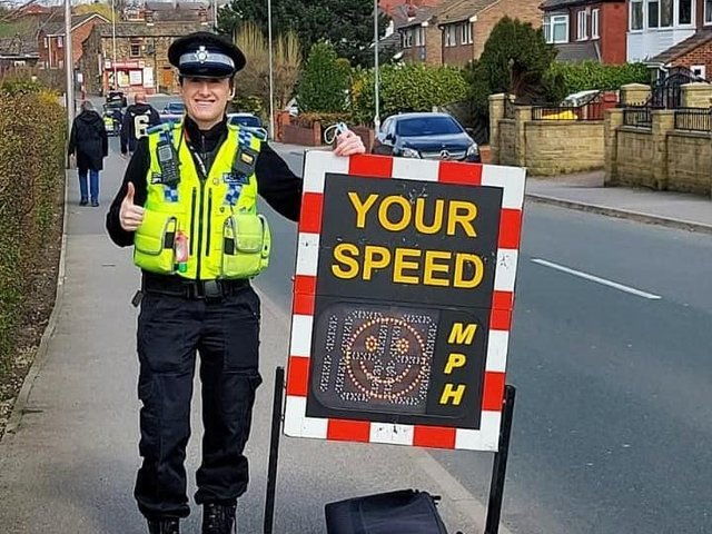 An officer from Leeds South NPT with the speed awareness device (Photo: WYP)