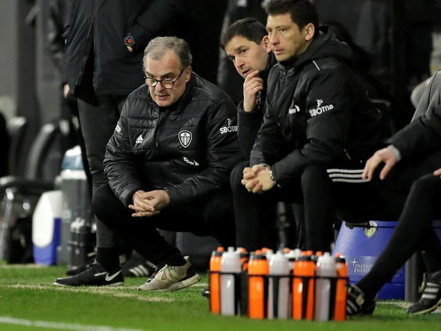 CAUTION: From Leeds United head coach Marcelo Bielsa, left, pictured during Friday night's 2-1 victory at Fulham which put the Whites on to 39 points for the Premier League campaign. Photo by MATT DUNHAM/POOL/AFP via Getty Images.