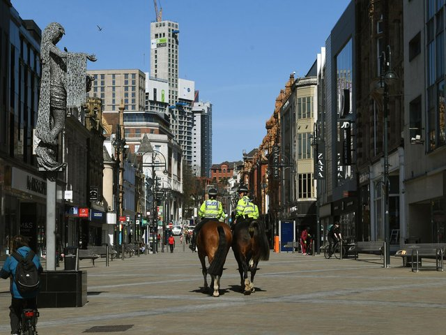 Police patrol Briggate on horses during the first lockdown
