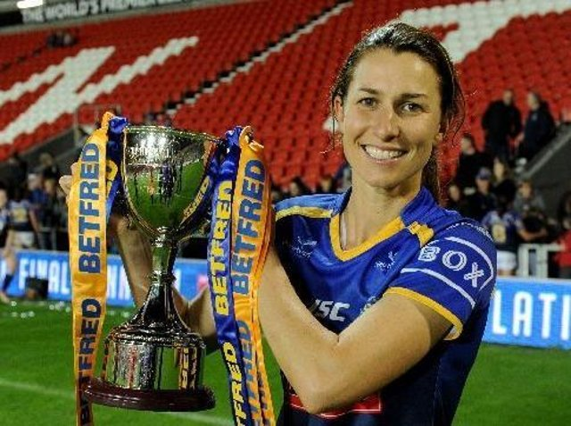 Rhinos captain Courtney Hill with the Betfred Women's Super League trophy. Picture by Steve Riding.