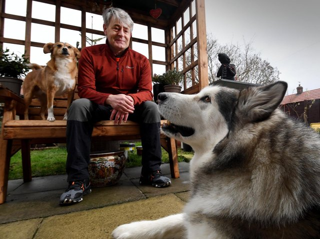 Vic Ferguson pictured with his dogs Mishka and Amber.  Picture by Simon Hulme