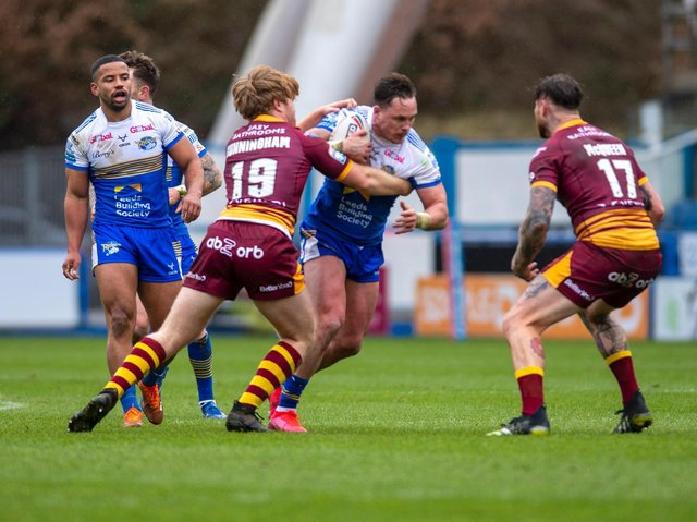 James Donaldson in possession for Rhinos in this month's pre-season game at Huddersfield. Picture by Tony Johnson.