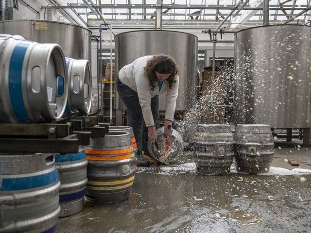 Katie Marriott pouring beer down the drain at Nomadic Beers in Leeds.