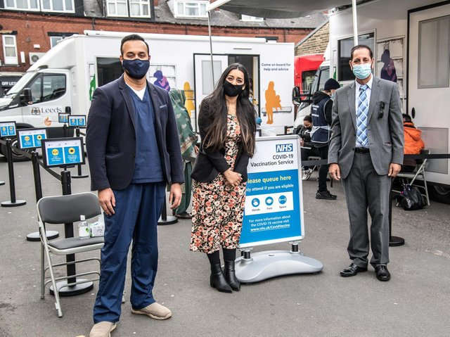 Pictured at the new vaccine minibus are: Coun Salma Arif, executive member for health and wellbeing at Leeds City Council, Dr Kashif Sarwar, GP and clinical director for Beeston Primary Care Network and Coun Mohammed Iqbal (Lab, Hunslet and Riverside). Picture: Jude Palmer  Cllr Arif, Dr Sarwar, Cllr Iqbal