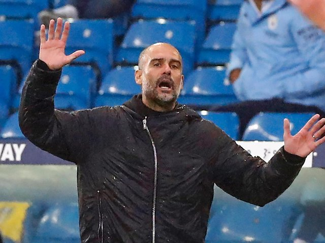NOT THEM AGAIN: Manchester City boss Pep Guardiola during October's breathless 1-1 draw against Leeds United at Elland Road. Photo by JASON CAIRNDUFF/POOL/AFP via Getty Images.