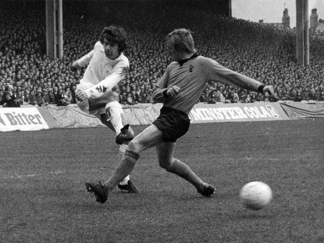 HOT SHOT: Leeds United's Peter Lorimer, left, powers the ball past Wolves defender Derek Parkin back in April 1973. Picture by YPN.
