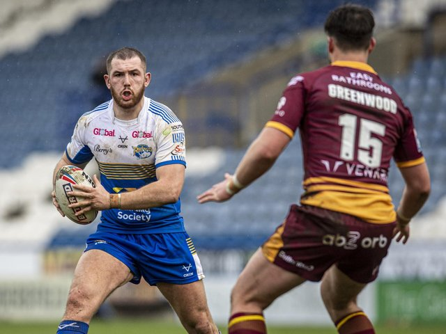 Cameron Smith on the attack in Rhinos' pre-season game at Huddersfield. Picture by Tony Johnson.