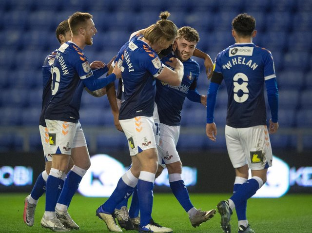 Leeds United's Alfie McCalmont (middle) celebrates with his Oldham teammates. Pic: Getty