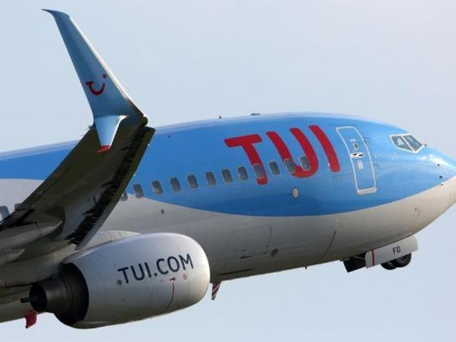 Travel company Tui has cut its summer holiday schedules amid new coronavirus restrictions in Europe. PA.
