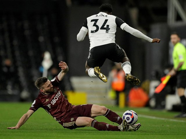 VERSATILE: Leeds United's Stuart Dallas tackles Fulham's Ola Aina during Friday night's 2-1 victory at Craven Cottage. Photo by MATT DUNHAM/POOL/AFP via Getty Images.