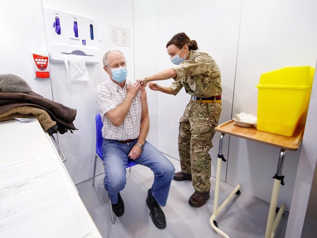 Richard Moss, 73, receives an injection of the the Oxford/AstraZeneca coronavirus vaccine from Lance Corporal Carla Fraser, Regimental Aid Post 4th Battalion Royal Regiment of Scotland, at the Elland Road vaccination centre in Leeds (photo: PA Wire/ Danny Lawson)