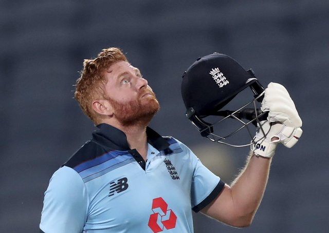 Up to the heavens: England's Jonny Bairstow looks skywards in celebration after smashing a century against India in the second One Day International at Maharashtra Cricket Association Stadium in Pune yesterday. (Picture: AP/Rafiq Maqbool)