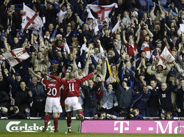 Leeds United and England striker Robbie Fowler celebrates at Elland Road.