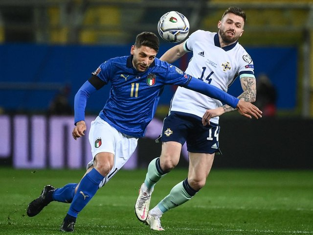 TOUGH OPENER: Leeds United's Stuart Dallas chases Italy's Domenico Berardi during Northern Ireland's 2-0 defeat in Thursday night's World Cup qualifier in Parma. Photo by MARCO BERTORELLO/AFP via Getty Images.