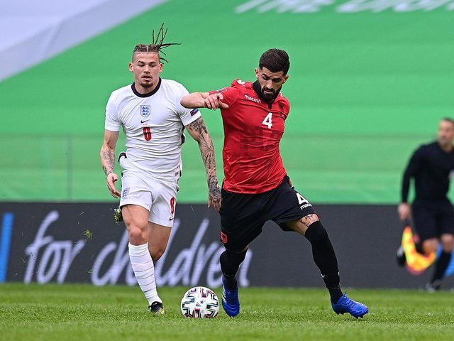 SIXTH CAP: England's Leeds United midfielder Kalvin Phillips, left, battles for possession with Albania's Elseid Hysaj during Sunday night's World Cup qualifier in Tirana. Photo by Mattia Ozbot/Getty Images.