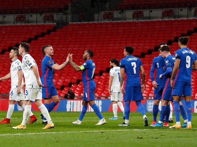 EXALTED COMPANY: Leeds United midfielder Kalvin Phillips, third left, congratulates England team mate Raheem Sterling after his strike in Thursday's 5-0 victory against San Marino. Photo by Frank Augstein - Pool/Getty Images.