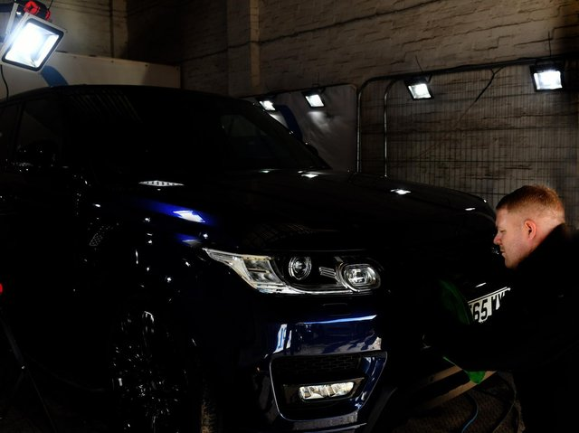 David Young, a detailing specialist working on a Land Rover at Car Love in Wakefield.