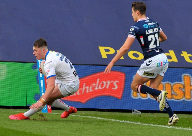 CLINCHER: Jack Broadbent scoring the winning try for Leeds Rhinos against Wakefield Trinity. Picture: Steve Riding.