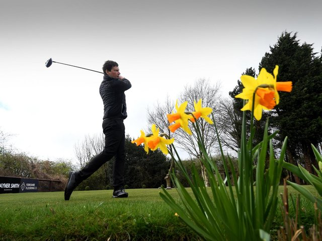 The first day of lockdown restrictions being lifted and golf Courses are open for business. Simon Booth tees off on the first tee at Horsforth Golf Club, Leeds. Picture by Simon Hulme