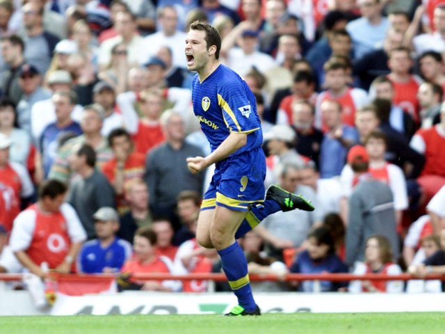 ELATION: Leeds United striker Mark Viduka celebrates his 88th-minute in the epic 3-2 success at Arsenal of May 2003. Picture by Tom Hevezi/PA Wire.
