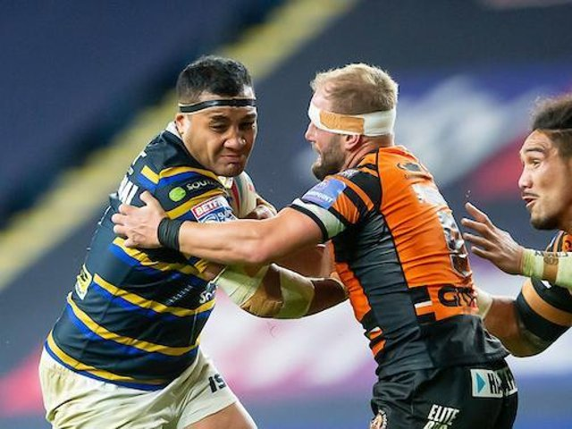 Ava Seumanufagai is tackled by Castleford's Paul McShane during his final Headingley appearance for Leeds last October. Picture by Allan McKenzie/SWpix.com.