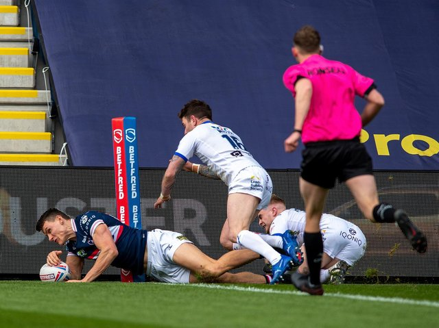 Innes Senior touches down for Trinity against Leeds. Picture by Bruce Rollinson.