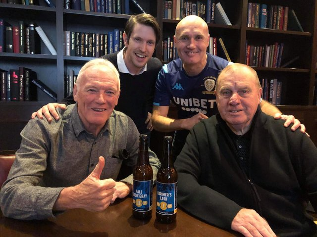 LUSCOS members Svend Karlsen and Anders Palm present Eddie Gray and Peter Lorimer with their special edition beer in February 2020.