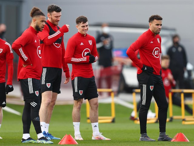 MOVING ON - Rob Page says Wales have dealt with the issue involving Leeds United attacker Tyler Roberts, left, and Hal Robson Kanu, right, and there will be no further ramifications. Pic: Getty