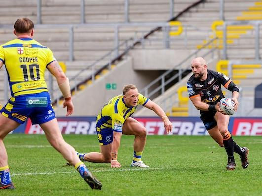 Former Rhinos hooker Paul McShane, pictured in possession against Warrington last week, is set to make his 150th appearance for Tigers. Picture by Alex Whitehead/SWpix.com.