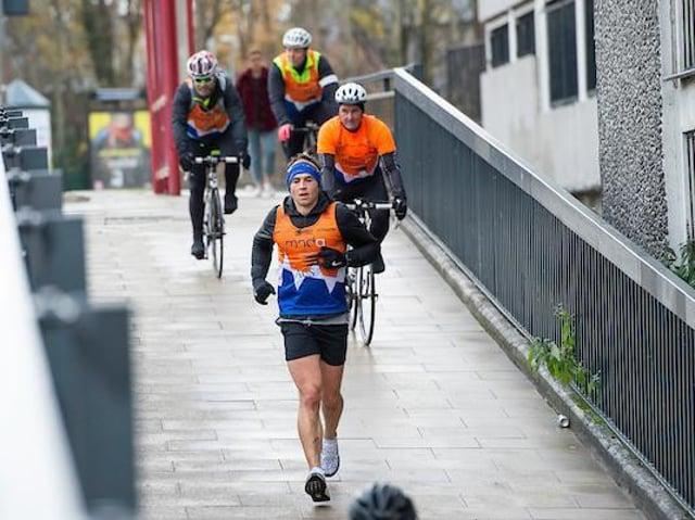 Kevin Sinfield runs through Leeds during one of last December's seven marathons in seven days. Picture by Allan McKenzie/SWpix.com.