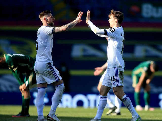 Leeds United captain Liam Cooper celebrates with Diego Llorente at full-time. Pic: Getty