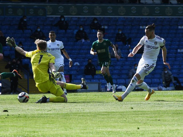 CLOSE: Leeds United winger Jack Harrison, right, is thwarted by Aaron Ramsdale, left, in his bid for a second goal in Saturday's 2-1 win against Sheffield United at Elland Road. Picture by Jonathan Gawthorpe.