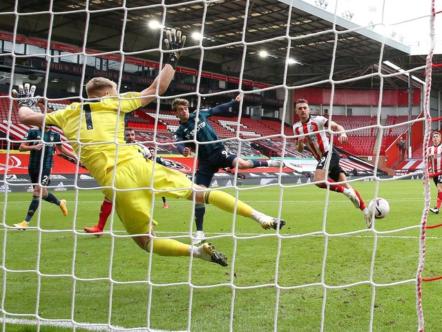 LEAVING IT LATE: Patrick Bamford, centre, and Leeds United finally beat Sheffield United and 'keeper Aaron Ramsdale in the 88th minute of September's clash against Sheffield United at Bramall Lane, above. Photo by Alex Livesey/Getty Images.