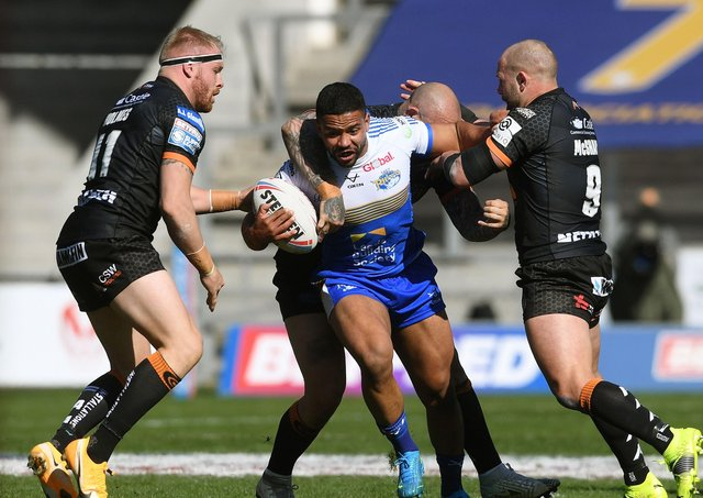 TOUGH DAY: Leeds Rhinos' Kruse Leeming finds his path blocked by Castleford Tigers at the TW Stadium. Picture: Jonathan Gawthorpe
