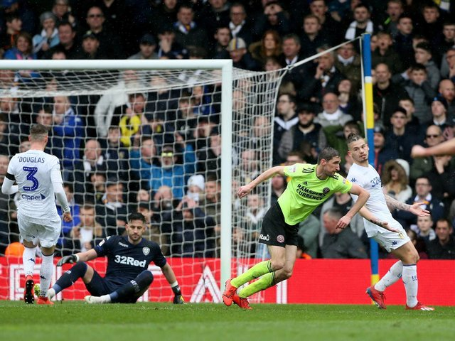 HOW THINGS WERE: From left, Leeds United trio Barry Douglas, Kiko Casilla and Kalvin Phillips look on as Chris Basham scores the only goal of Sheffield United's 1-0 triumph at Elland Road of March 2018. Picture by Richard Sellers/PA Wire.