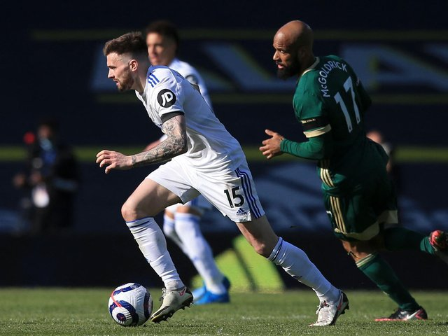KEEPING AHEAD: Leeds United's Stuart Dallas, left, is chased by Sheffield United's David McGoldrick in Saturday's clash at Elland Road. Photo by LINDSEY PARNABY/POOL/AFP via Getty Images.